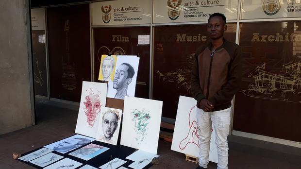 Artist displays sketches outside Department of Arts and Culture